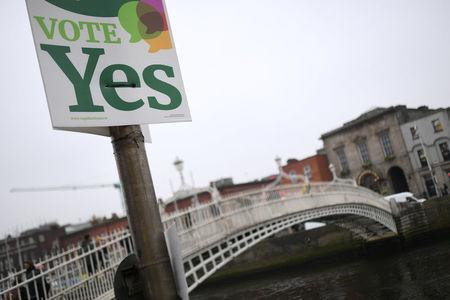 A Vote Yes poster is seen beside the Ha'Penny bridge ahead of a 25th May referendum on abortion law in Dublin