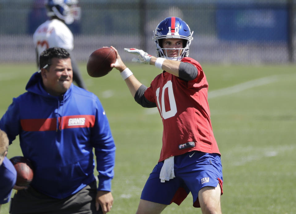 New York Giants' Eli Manning throws a pass during an NFL football minicamp at the team's training facility Tuesday, June 4, 2019, in East Rutherford, N.J. (AP Photo/Frank Franklin II)