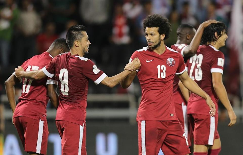 Qatar players celebrate scoring a goal during the 2018 World Cup qualifying match against Hong Kong in Doha (AFP Photo/Karim Jaafar)