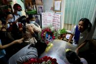 People mourn as they attend the funeral of Kyaw Win Maung, who was shot and killed during a protest against the military coup, in Mandalay