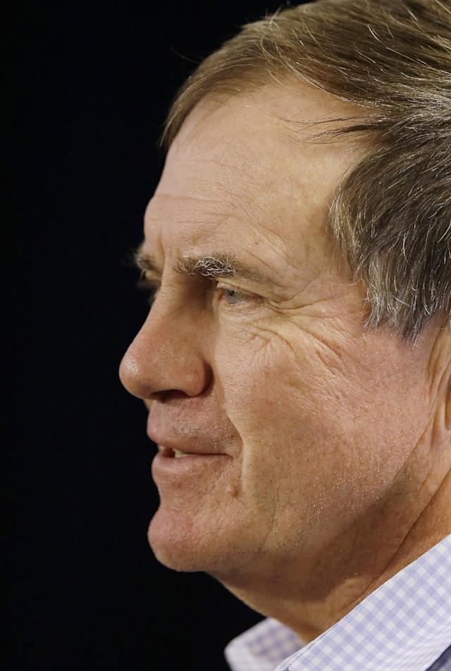 New England Patriots head coach Bill Belichick smiles as he respond's to a reporter's question during a media availability at the NFL football team's facility in Foxborough, Mass., Monday, Jan. 20, 2014. The Patriots lost to the Denver Broncos in the AFC Championship game Sunday in Denver ending their season. (AP Photo/Stephan Savoia)