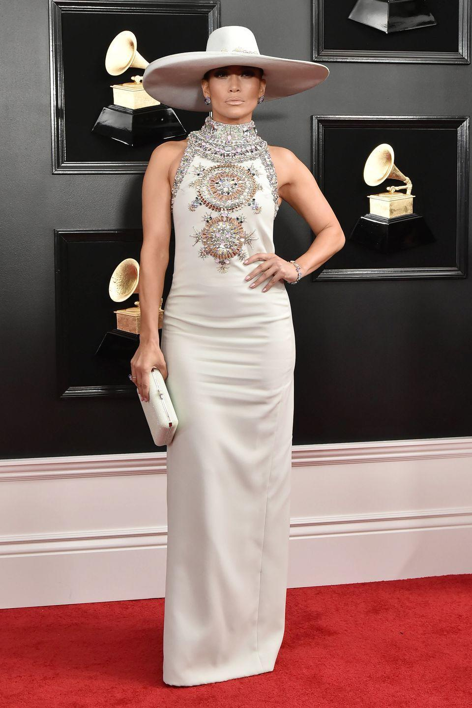"<p>If anyone can pull off a hat on the red carpet, that person would be J.Lo. Here, she wears a Ralph and Russo dress to the Grammy Awards, where she performed a (<a href=""https://www.cosmopolitan.com/entertainment/a26287610/jennifer-lopez-motown-tribute-grammys-2019-response/"" rel=""nofollow noopener"" target=""_blank"" data-ylk=""slk:somewhat controversial"" class=""link rapid-noclick-resp"">somewhat controversial</a>) Motown tribute. </p>"