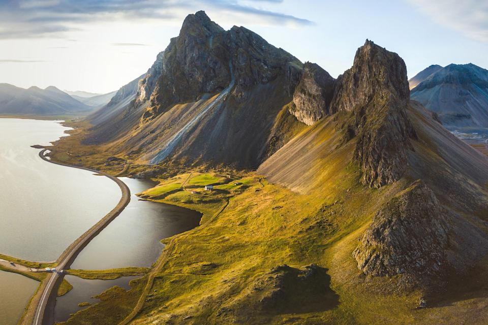 """There really is no wrong time to visit Iceland, but we're particularly fond of chasing the midnight sun during July—the more daylight hours for exploring, the better. (It's been open to vaccinated travelers since April 6.) The summer months also make certain parts of the country accessible that might not be in the winter, including the 34-mile Laugavegurinn hiking trail in the Central Highlands. The mountain huts and campsites along the trail are only open between late June and early September, giving you a small time window to experience the hot springs, black lava fields, and multicolored mountains along the path. If you prefer someone else to do the planning for you, take advantage of <a href=""""https://www.cntraveler.com/hotels/iceland/hella/hotel-ranga?mbid=synd_yahoo_rss"""" rel=""""nofollow noopener"""" target=""""_blank"""" data-ylk=""""slk:Hotel Rangá"""" class=""""link rapid-noclick-resp"""">Hotel Rangá</a>'s new """"Seven Days of Fun Under the Midnight Sun"""" package, which includes includes accommodations for two (plus a seventh night for free) and outdoor excursions across the island. Whether you want to go horseback riding or snowmobiling on top of the Eyjafjallajökull volcano, one of the hotel's guides will help you out."""