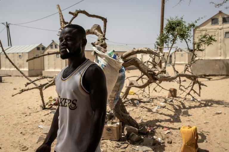 Many locals have had little choice but to move to a displacement camp inland as their homes have been swallowed up by the raging sea, coastal erosion and the crumbling ground beneath them (AFP/JOHN WESSELS)
