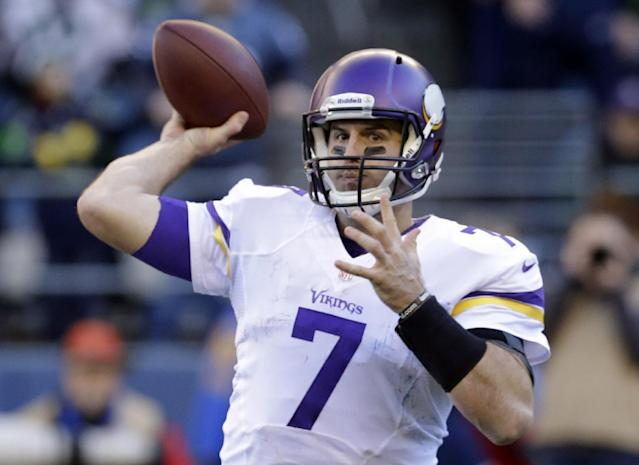 Minnesota Vikings quarterback Christian Ponder throws against the Seattle Seahawks in the first half of an NFL football game Sunday, Nov. 17, 2013, in Seattle. (AP Photo/Ted S. Warren)