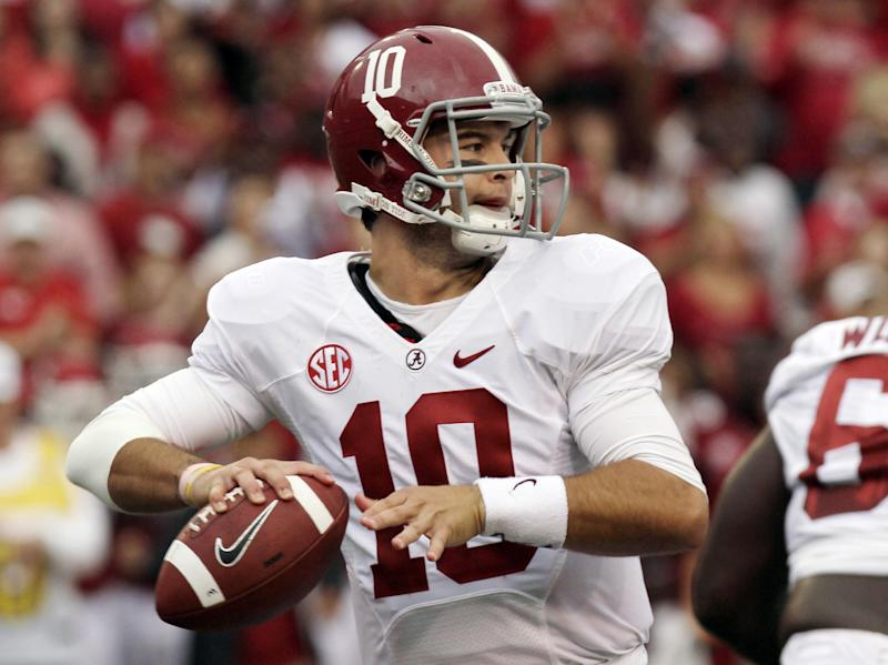 Alabama quarterback AJ McCarron passes during the first quarter of an NCAA college football game against Arkansas in Fayetteville, Ark., Saturday, Sept. 15, 2012. (AP Photo/Danny Johnston)