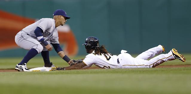Pittsburgh Pirates' Andrew McCutchen, right, is tagged out by San Diego Padres shortstop Ronny Cedeno as he tries to steal second base in the first inning of a baseball game Wednesday, Sept. 18, 2013, in Pittsburgh. (AP Photo/Keith Srakocic)