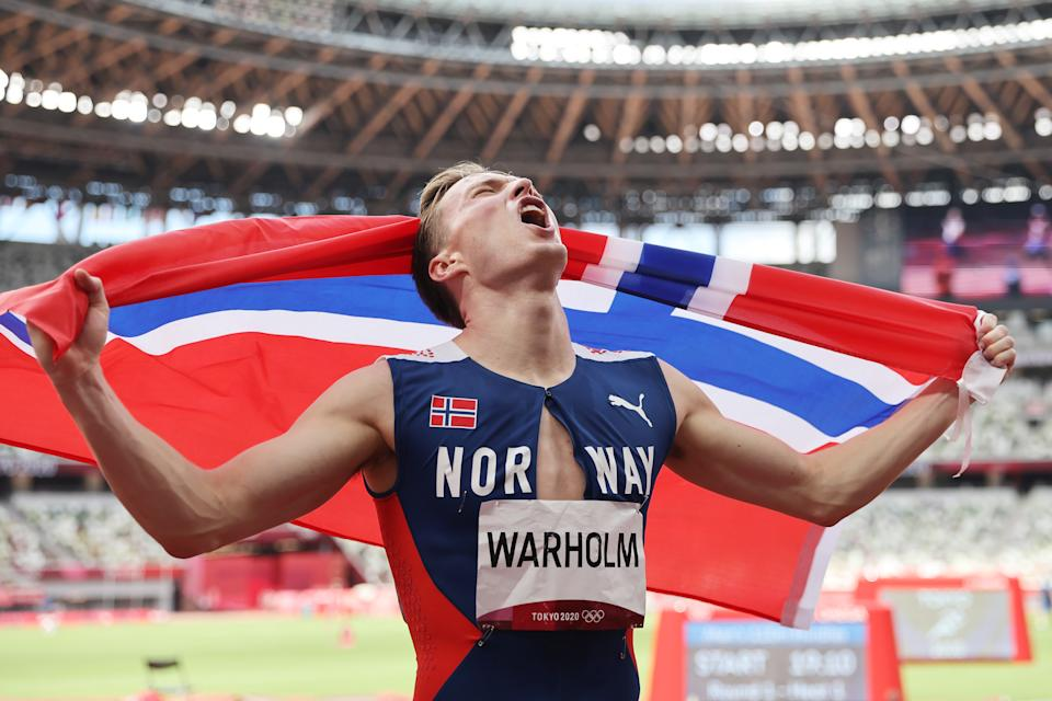 TOKYO, Japan - August 03: Norway's Carsten Warholm reacts after winning gold in the men's 400m final at the Tokyo 2020 Olympic Stadium on August 11, 2021 in Tokyo, Japan.  (Photo by Patrick Smith / Getty Images)