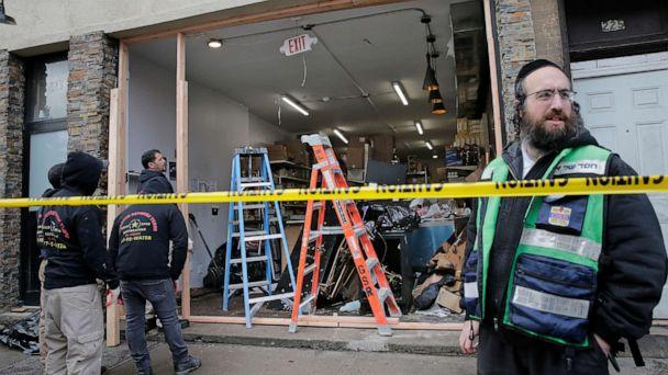 PHOTO: In this Wednesday, Dec. 11, 2019, file photo, people work to secure the scene of a shooting at a kosher supermarket in Jersey City, N.J. On Friday, Dec. 13, 2019. (Seth Wenig/AP Photo)