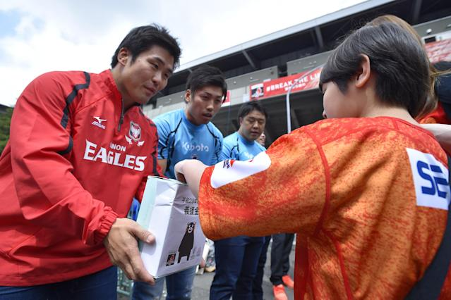 TOKYO, JAPAN - APRIL 23: Players of Japan ask for donations of support for the victims of the earthquake in Kumamoto prior to the round nine Super Rugby match between the Sunwolves and the Jauares at Prince Chichibu Memorial Ground on April 23, 2016 in Tokyo, Japan. (Photo by Koki Nagahama/Getty Images)