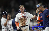 Houston Astros' Myles Straw (3) celebrates after scoring the game-winning run against the Texas Rangers during the 11th inning of a baseball game Thursday, May 13, 2021, in Houston. The Astros won 4-3 in 11 innings. (AP Photo/David J. Phillip)