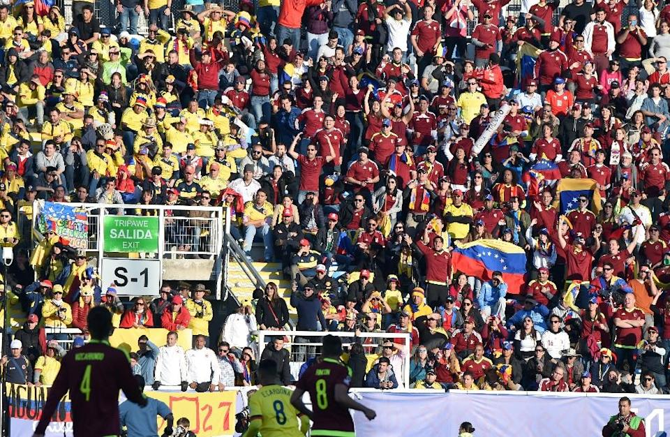 Supporters of Colombia (L) and Venezuela cheer during their 2015 Copa America football match in Rancagua, Chile, on June 14, 2015 (AFP Photo/Pablo Porciuncula)