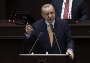 Turkey's President Recep Tayyip Erdogan addresses his ruling party lawmakers at the parliament, in Ankara, Turkey, Wednesday, Oct. 28, 2020. Erdogan told his ruling party's legislators on Wednesday that he had a fruitful telephone conversation with Russian President Vladimir Putin the previous evening, during which he proposed that Ankara and Moscow work together to resolve the conflict by using their influence on the Azerbaijani and Armenian leaders. (AP Photo)
