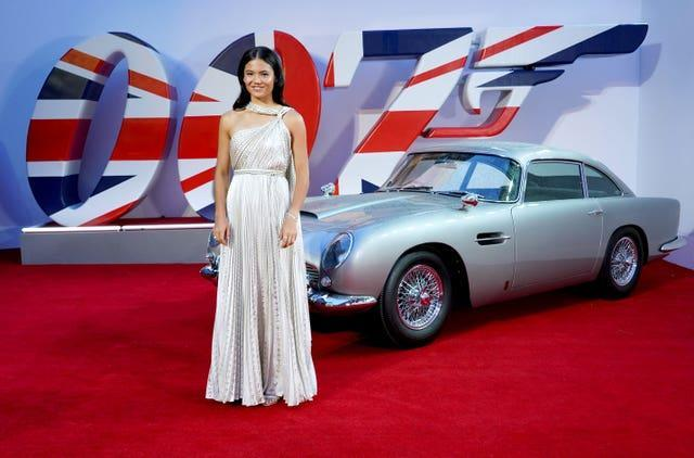 Emma Raducanu stands in front of an Aston Martin at the world premiere of No Time To Die