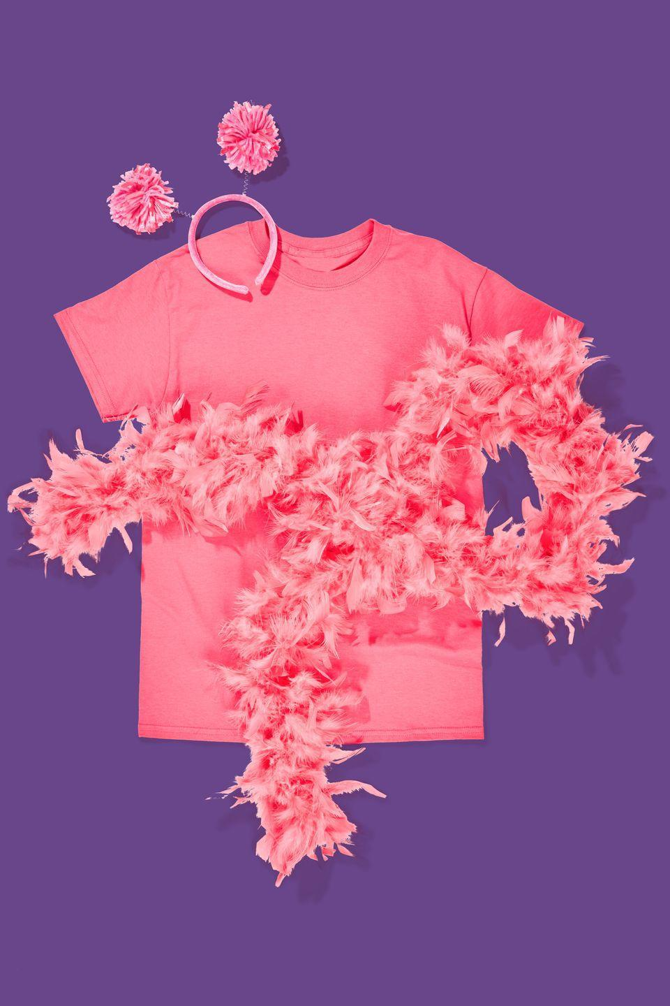 """<p>Grab a pink t-shirt, feather boa, and pom-pom <span class=""""redactor-unlink"""">headband, then make sure to keep the LOLs going all night long. </span></p><p><strong><a class=""""link rapid-noclick-resp"""" href=""""https://www.amazon.com/Lux-Accessories-Rainbow-Tinsel-Headband/dp/B07B8KSYLW/?tag=syn-yahoo-20&ascsubtag=%5Bartid%7C10070.g.490%5Bsrc%7Cyahoo-us"""" rel=""""nofollow noopener"""" target=""""_blank"""" data-ylk=""""slk:SHOP POM-POM HEADBANDS"""">SHOP POM-POM HEADBANDS</a><br></strong></p>"""