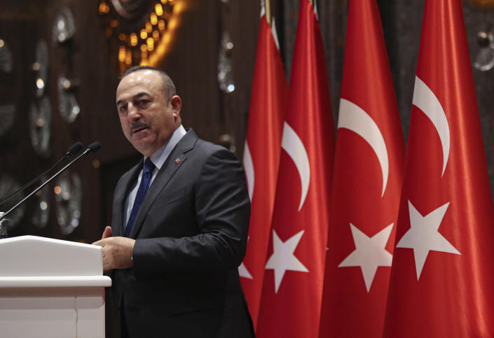 Turkish Foreign Minister Mevlut Cavusoglu speaks during a meeting in Ankara, Turkey, Tuesday, Feb. 4, 2020. Cavusoglu said Tuesday Ankara and Moscow were trying to keep peace efforts for Syria alive despite Syrian government advances and a deadly clash between Turkish and Syrian forces in northern Syria. (Turkish Foreign Ministry via AP, Pool)