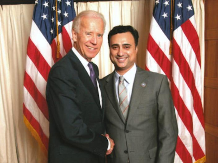Imaad Zuberi, who faces 12 years in prison, shakes hands with then-Vice President Joe Biden.