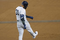 New York Yankees' Aaron Hicks (31) reacts after flying out to deep center field during the fourth inning of the team's baseball game against the Atlanta Braves, Wednesday, April 21, 2021, at Yankee Stadium in New York. (AP Photo/Kathy Willens)