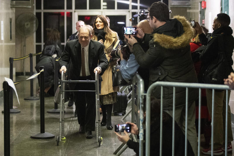FILE - In this Tuesday, Jan. 14, 2020, file photo, Harvey Weinstein, left, leaves court for the day, followed by his attorney Donna Rotunno, second from left, during jury selection in his trial on rape and sexual assault charges, in New York. State Supreme Court Justice James Burke is not permitting cameras in the courtroom during Weinstein's trial. Any depiction of Weinstein listening to testimony in the trial will come from sketch artists. (AP Photo/Mary Altaffer, File)