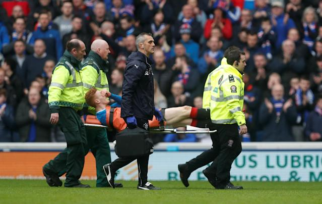 Soccer Football - Scottish Premiership - Rangers vs Celtic - Ibrox, Glasgow, Britain - March 11, 2018 Rangers' David Bates is stretchered off after sustaining an injury REUTERS/Russell Cheyne