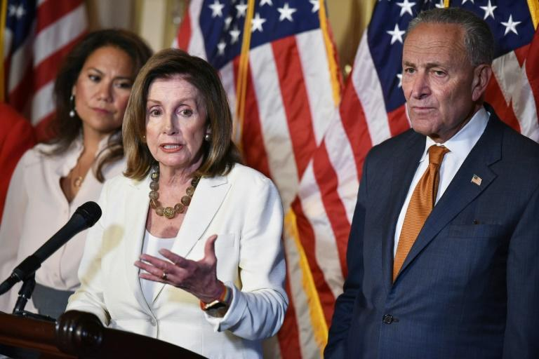 House Speaker Nancy Pelosi (C), Senate Minority Leader Chuck Schumer and congresswoman Veronica Escobar are among the Democrats demanding top Senate Republican Mitch McConnell hold a vote on gun control legislation (AFP Photo/MANDEL NGAN)