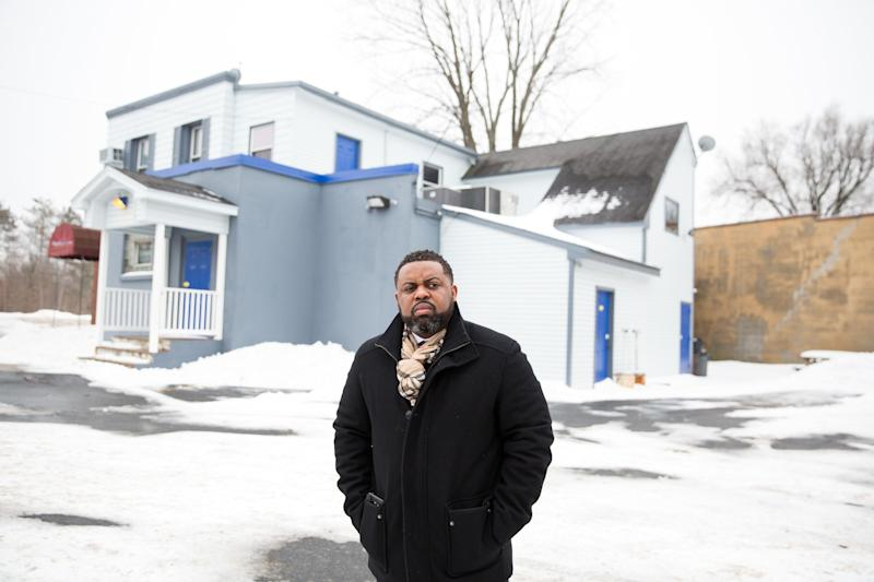 "Lamar Cook, 37, stands outside the nightclub where his brother was killed in June 2017. ""When you're going back to suburban America every day, those kind of things are not within your realm,"" he said of the gun CEOs."