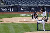 New York Yankees Aaron Judge at bat against pitcher Jordan Montgomery in front of catcher Kyle Higashioka during a baseball workout at Yankee Stadium in New York, Saturday, July 4, 2020. (AP Photo/Adam Hunger)