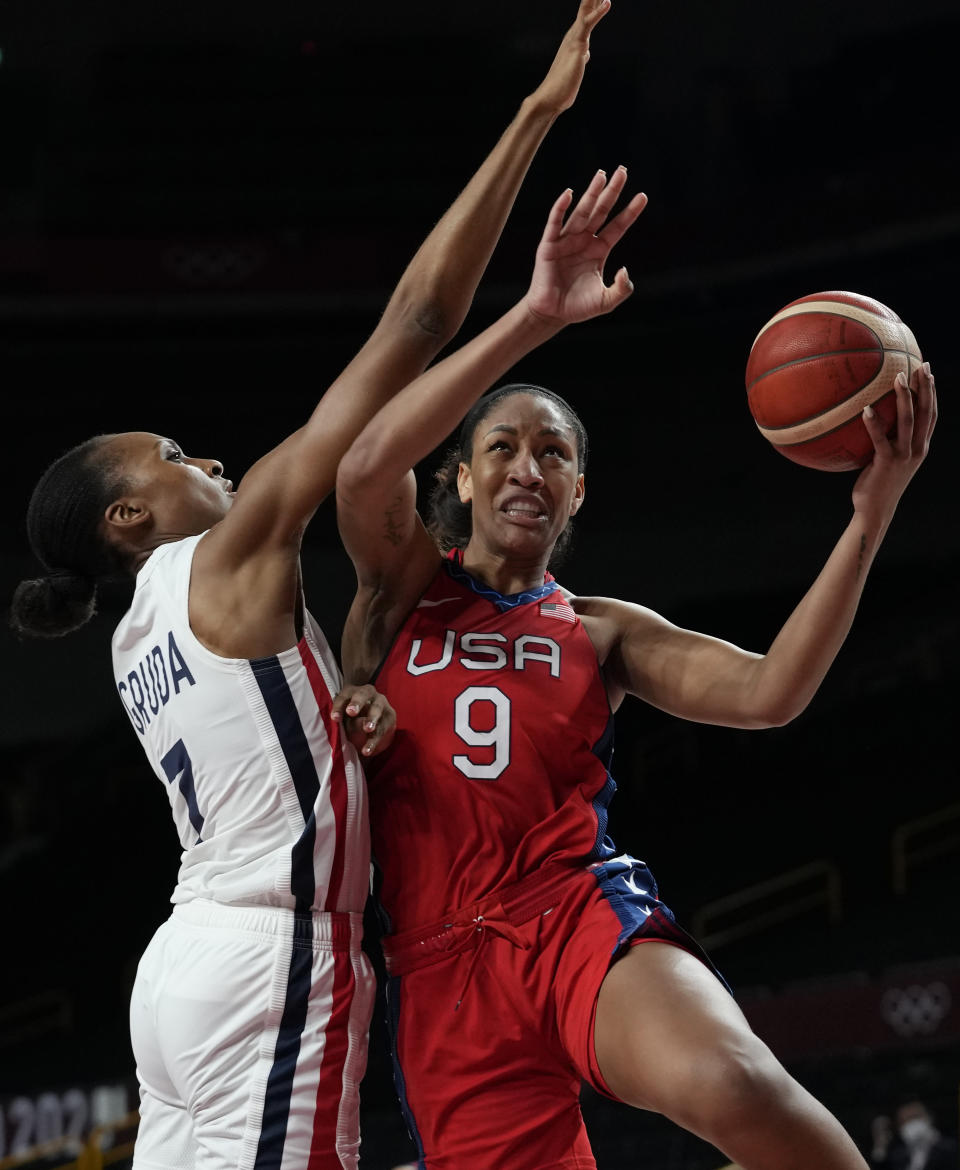 United States' A'Ja Wilson (9) drives against France's Sandrine Gruda (7) during women's basketball preliminary round game at the 2020 Summer Olympics, Monday, Aug. 2, 2021, in Saitama, Japan. (AP Photo/Eric Gay)