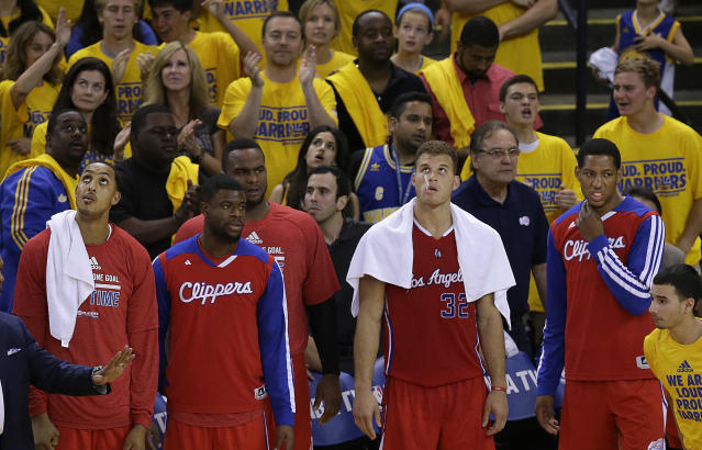 Los Angeles Clippers center Ryan Hollins, from left, guard Reggie Bullock, forward Glen Davis, forward Blake Griffin, and forward Danny Granger stand on the sideline during the fourth quarter of Game 6 of an opening-round NBA basketball playoff series against the Golden State Warriors in Oakland, Calif., Thursday, May 1, 2014. The Warriors won 100-99. (AP Photo/Jeff Chiu)
