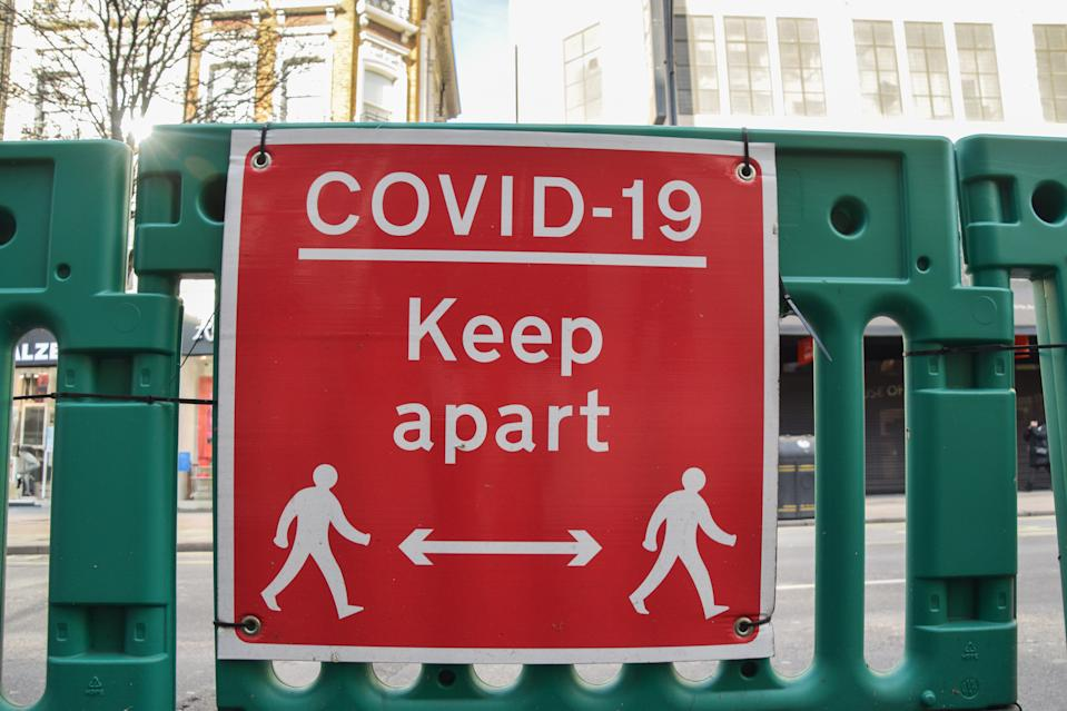 'COVID-19 Keep Apart' sign on Oxford Street, London.Most businesses remain shut in the UK as the nation continues to battle with the coronavirus pandemic. (Photo by Vuk Valcic/SOPA Images/LightRocket via Getty Images)