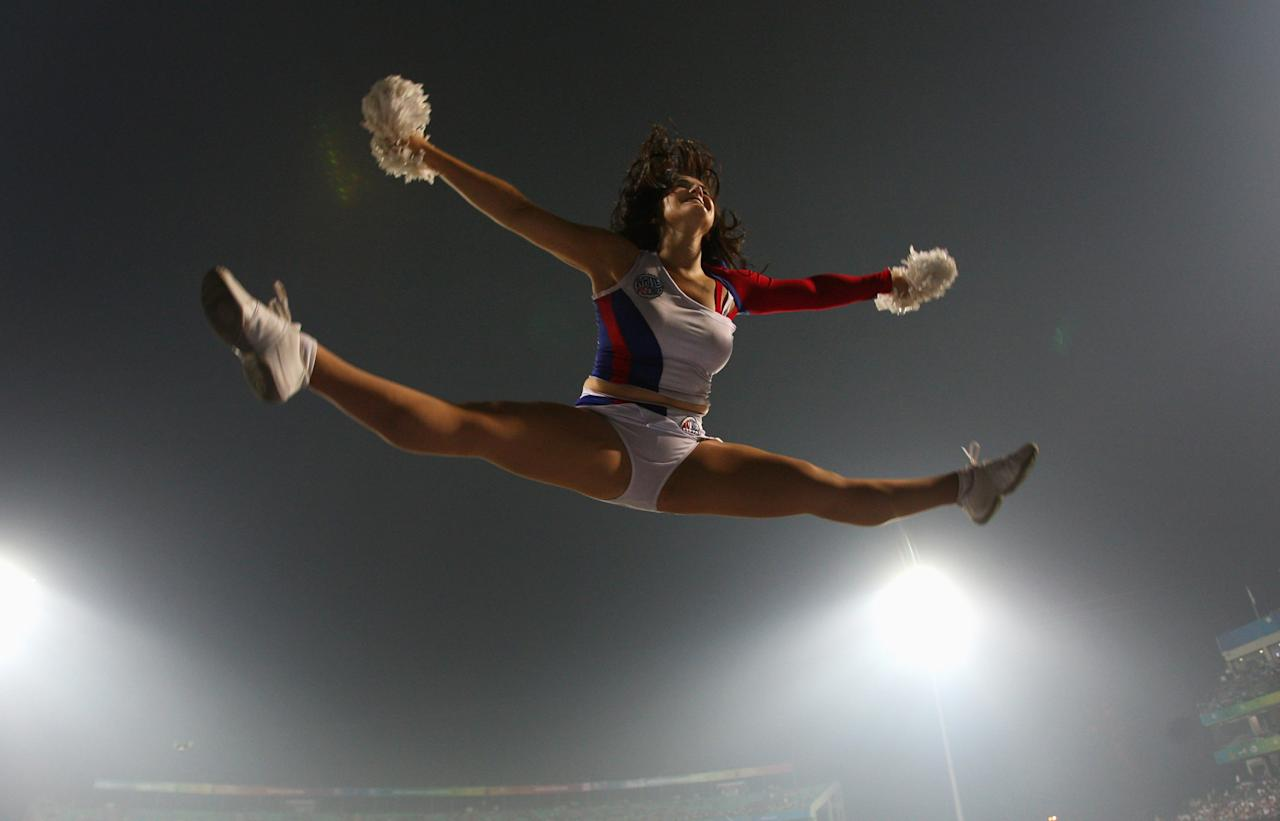 DELHI, INDIA - OCTOBER 21:  A cheerleader in action during the Airtel Champions League Twenty20 1st semi final match between the Victoria Bushrangers and NSW Blues at Feroz Shah Kotla stadium on October 21, 2009 in Delhi, India.  (Photo by Stu Forster - GCV/GCV via Getty Images)