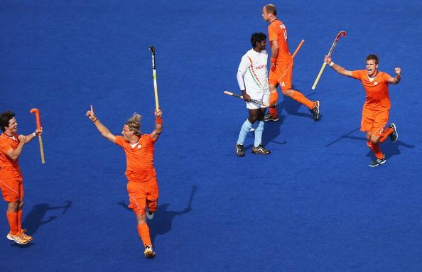 LONDON, ENGLAND - JULY 30:  Roderick Weusthof of the Netherlands celebrates after scoring his goial against India during the Men's Hockey Match on Day 3 of the London 2012 Olympic Games at the Riverbank Arena on July 30, 2012 in London, England.  (Photo by Daniel Berehulak/Getty Images)