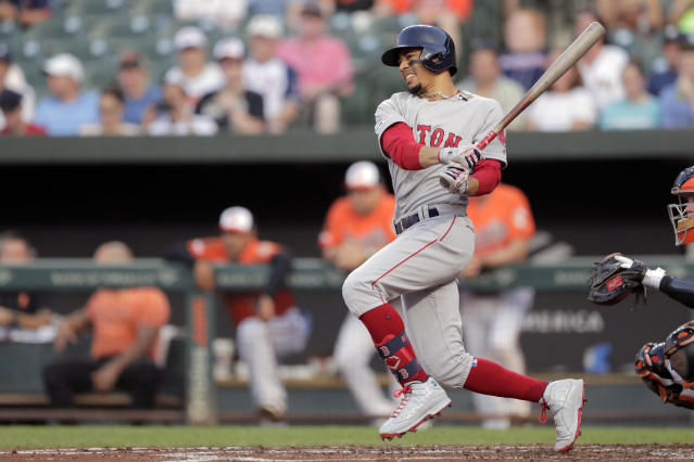 Boston Red Sox's Mookie Betts swings at a pitch from Baltimore Orioles starting pitcher Thomas Eshelman during the second inning of a baseball game, Saturday, July 20, 2019, in Baltimore. (AP Photo/Julio Cortez)