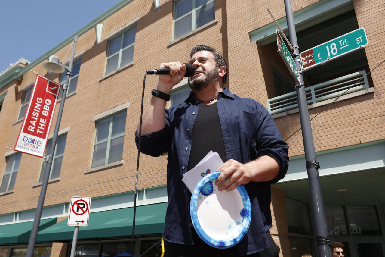 "IMAGE DISTRIBUTED FOR DIXIE ULTRA' - Adam Richman, Dixie Ultra® ambassador and noted TV personality and food enthusiast, addresses the crowd on Saturday, July 22, 2017, in Kansas City, during the Dixie Ultra® ""Raising the BBQ"" event, designed to put the brand's new heavy-duty paper plates through the ultimate stress test. (Photo by Colin Braley/AP Images for Dixie Ultra®)"