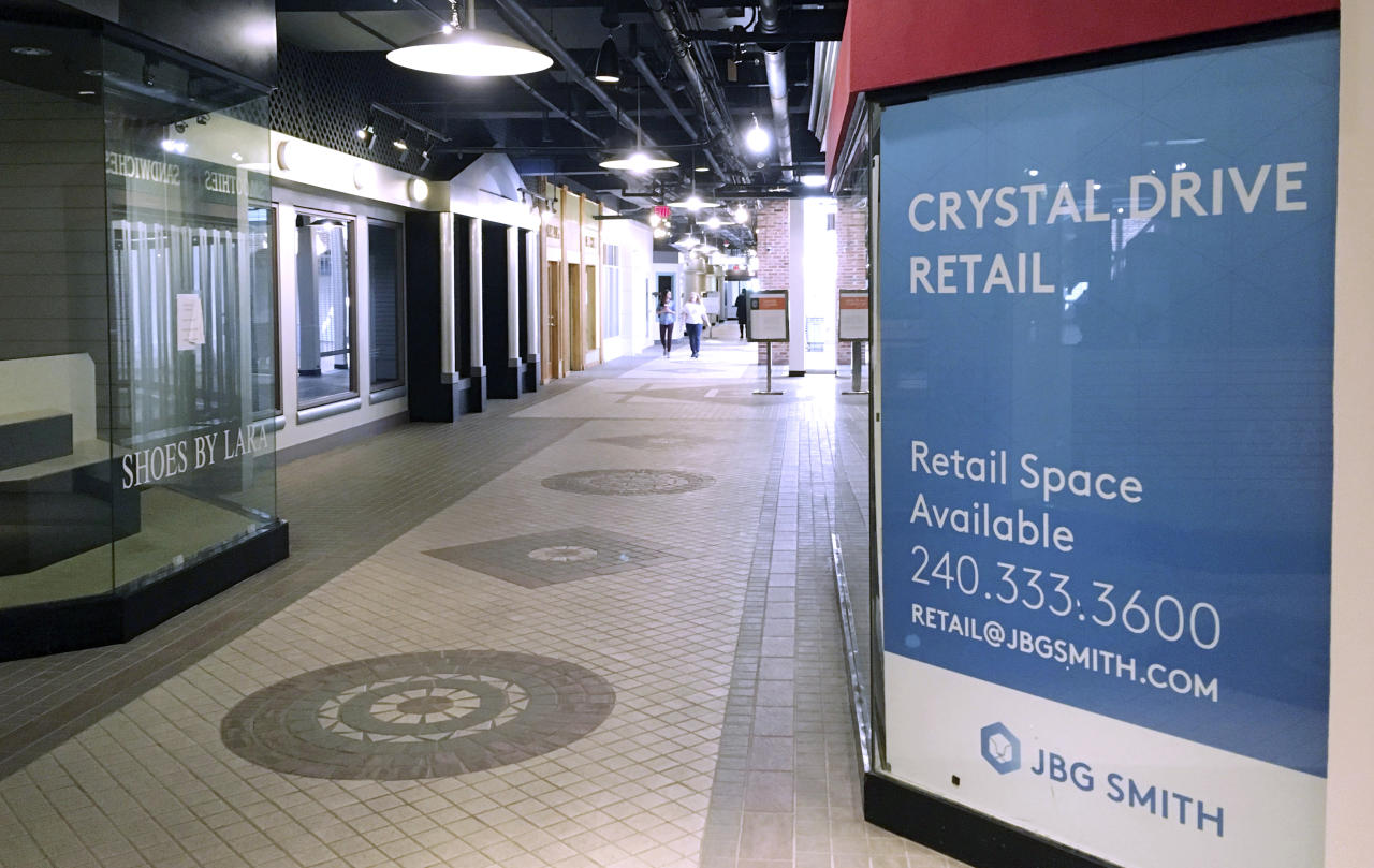 In this Thursday, Nov. 8, 2018, photo, pedestrians walk the underground corridors in Crystal City, Va. If any place in the U.S. is well positioned to absorb 25,000 Amazon jobs, it may well be Crystal City, which has lost nearly that many jobs over the last 15 years. The community wedged between the nation's capital, Reagan National Airport and the Pentagon, has abundant infrastructure, including rail transit and available commercial space. (AP Photo/Matthew Barakat)
