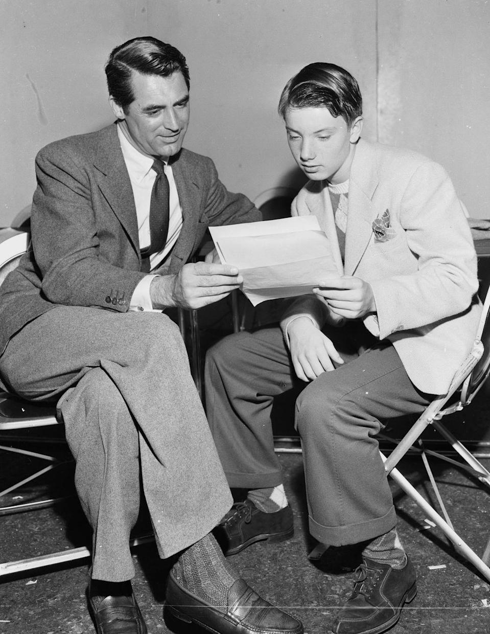 <p>The year he turned 40, Grant would appear in three movies, including one of his best, Arsenic and Old Lace. (In this picture, he's rehearsing lines for a radio program.)</p>