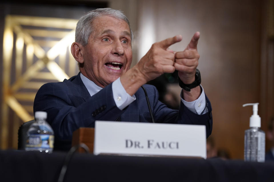 Top infectious disease expert Dr. Anthony Fauci responds to accusations by Sen. Rand Paul, R-Ky., as he testifies before the Senate Health, Education, Labor, and Pensions Committee about the origin of COVID-19, on Capitol Hill in Washington, Tuesday, July 20, 2021. Cases of COVID-19 have tripled over the past three weeks, and hospitalizations and deaths are rising among unvaccinated people. (AP Photo/J. Scott Applewhite, Pool)
