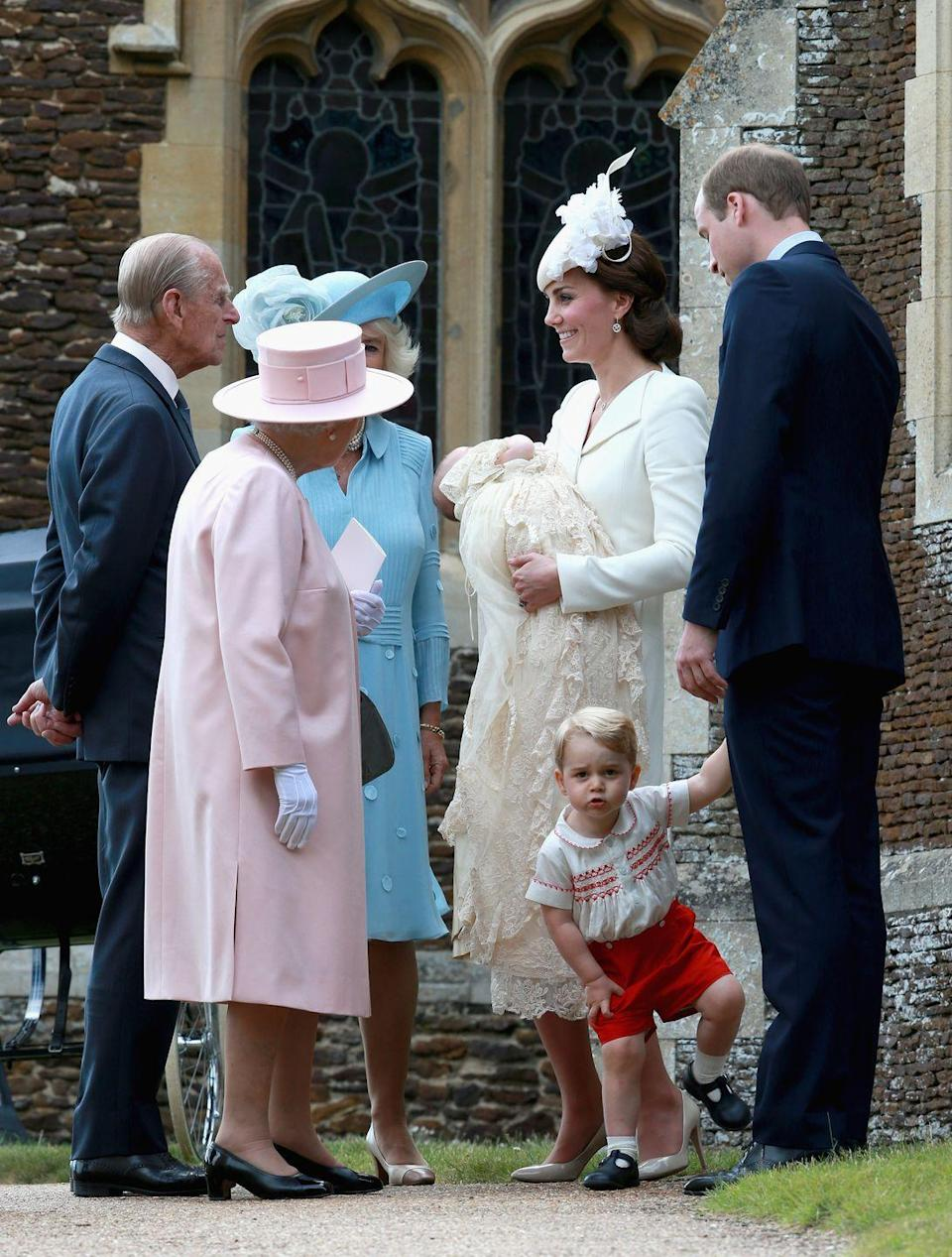 <p>Like any good grandparents, Prince Philip, 94, and Queen Elizabeth II, 89, enjoy cooing over their grandchildren any chance they get. Here, the couple celebrate Princess Charlotte at her July 5 christening on the Sandringham Estate in King's Lynn, England. </p>