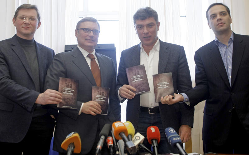 From left: Vladimir Ryzhkov, Mikhail Kasyanov, Boris Nemtsov, Vladimir Milov seen during a news conference in Moscow, Monday, March 28, 2011. Ex-Prime Minister Mikhail Kasyanov, Boris Nemtsov, a former deputy premier, and two other opposition figures on Monday presented their report on alleged corruption under Putin's rule. Russian opposition figures have alleged that corruption in Russia has worsened under Prime Minister Vladimir Putin and that his friends and relatives have used their position for personal gain. (AP Photo/Mikhail Metzel)