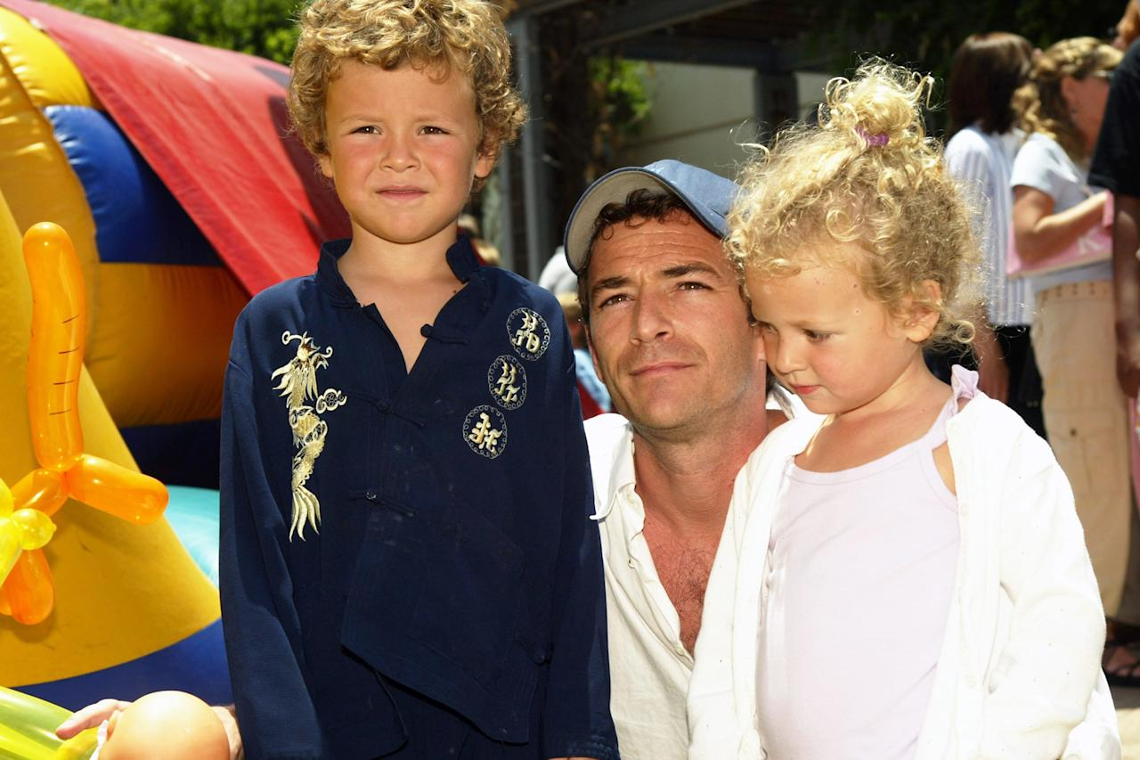 In 2004, Perry brought his children to the <em>Garfield: The Movie</em> world premiere in Los Angeles.