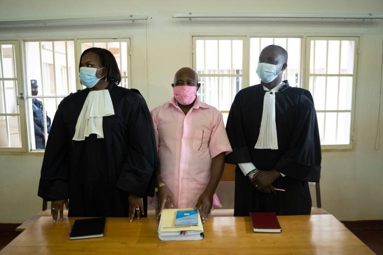 Rusesabagina, centre, seen in prison uniform at his court appearance in Kigali last October