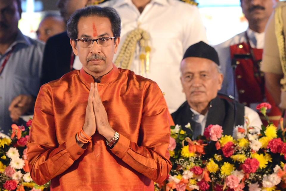 Maharashtra's Governor Bhagat Singh Koshyari (R) looks on as new chief minister Uddhav Thackeray gestures after taking his oath of office during a swearing-in ceremony in Mumbai on November 28, 2019. (Photo by STR / AFP) (Photo by STR/AFP via Getty Images)