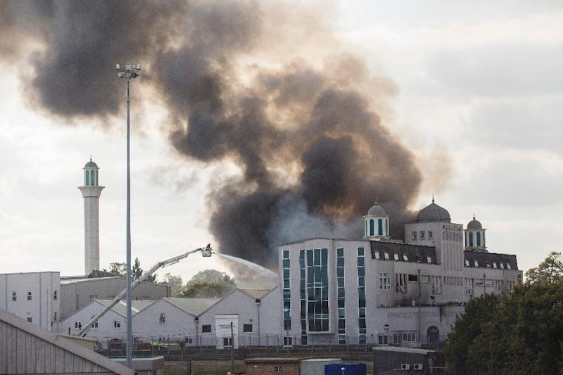 Firefighters tackle a blaze at the Baitul Futuh Mosque in Morden, south west London on September 26, 2015