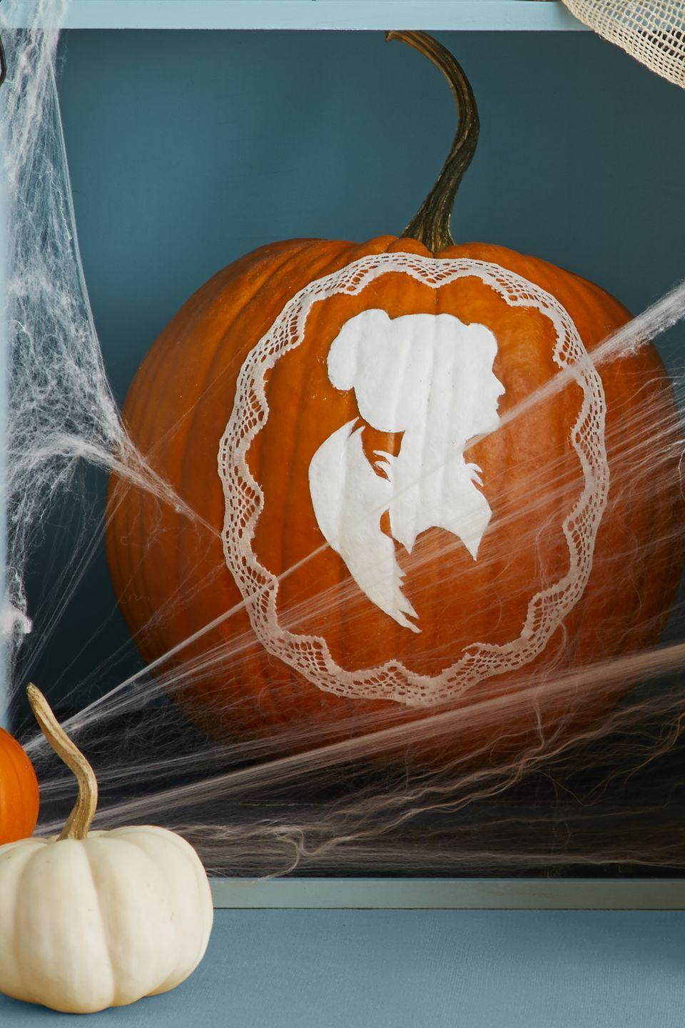 """<p>Print out a silhouette on regular paper, cut it out, paint it whatever color you'd like, then attach it to the pumpkin with glue or double-sided tape. To add an extra touch, grab any lace you have laying around the house and use it as a frame around the silhouette cut-out<a href=""""https://hmg-prod.s3.amazonaws.com/files/pumpkin-cameo-f-1627665153.pdf?tag=syn-yahoo-20&ascsubtag=%5Bartid%7C10070.g.331%5Bsrc%7Cyahoo-us"""" rel=""""nofollow noopener"""" target=""""_blank"""" data-ylk=""""slk:"""" class=""""link rapid-noclick-resp""""><br></a></p><p><a href=""""https://hmg-prod.s3.amazonaws.com/files/pumpkin-cameo-f-1627665153.pdf?tag=syn-yahoo-20&ascsubtag=%5Bartid%7C10070.g.331%5Bsrc%7Cyahoo-us"""" rel=""""nofollow noopener"""" target=""""_blank"""" data-ylk=""""slk:Get the free Silhouette Pumpkin stencil."""" class=""""link rapid-noclick-resp""""><strong><em>Get the free Silhouette Pumpkin stencil.</em></strong></a></p>"""