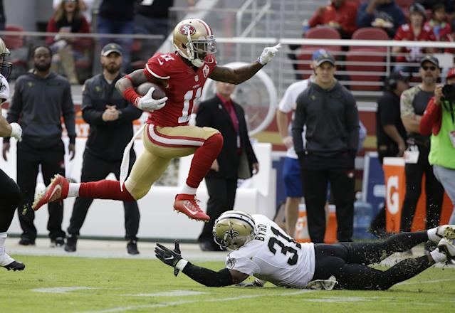<p>San Francisco 49ers wide receiver Quinton Patton runs with the ball over New Orleans Saints free safety Jairus Byrd during the first half of an NFL football game, Sunday, Nov. 6, 2016, in Santa Clara, Calif. (AP Photo/Tony Avelar) </p>