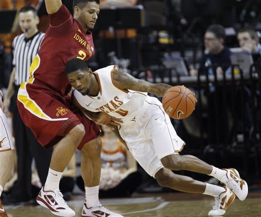 Texas' Julien Lewis, right, is defended by Iowa State's Chris Babb, left, during the first half of an NCAA college basketball game, Tuesday, Jan. 24, 2012, in Austin, Texas. (AP Photo/Eric Gay)