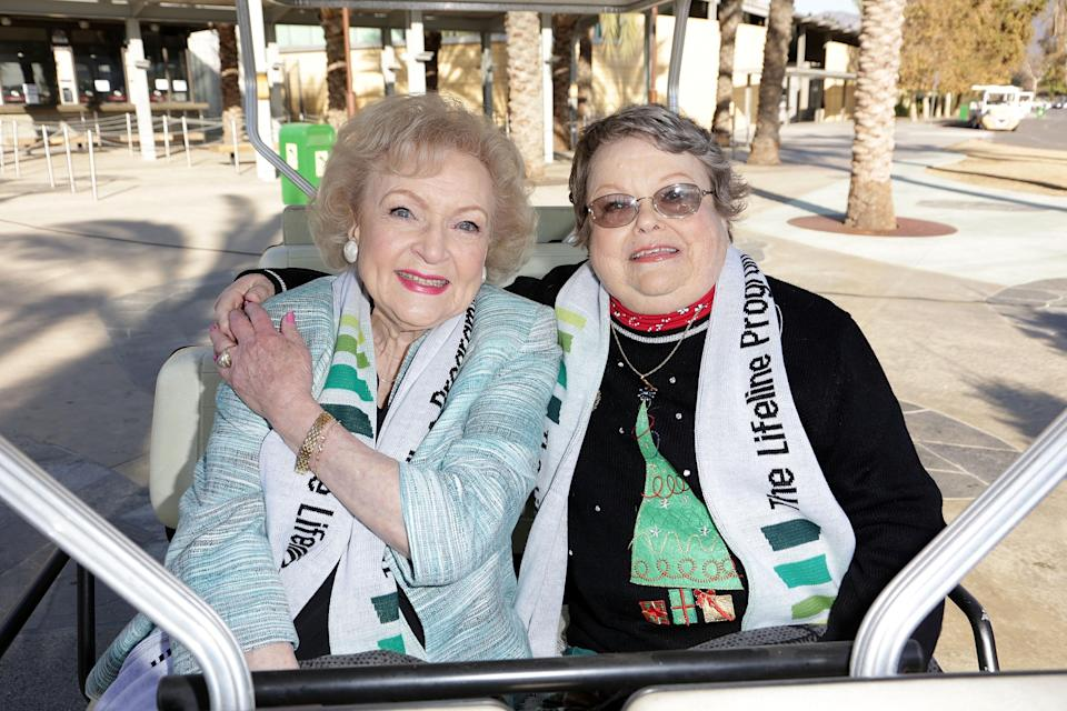 """LOS ANGELES, CA - DECEMBER 11: (L-R) Actress Betty White and winner of The Lifeline Program's national """"Bucket List"""" Facebook contest Leslie Scott attend Betty """"White Out"""" Tour at The Los Angeles Zoo with The Lifeline Program at Los Angeles Zoo on December 11, 2012 in Los Angeles, California. (Photo by Brian To/Getty Images for The Lifeline Program)"""