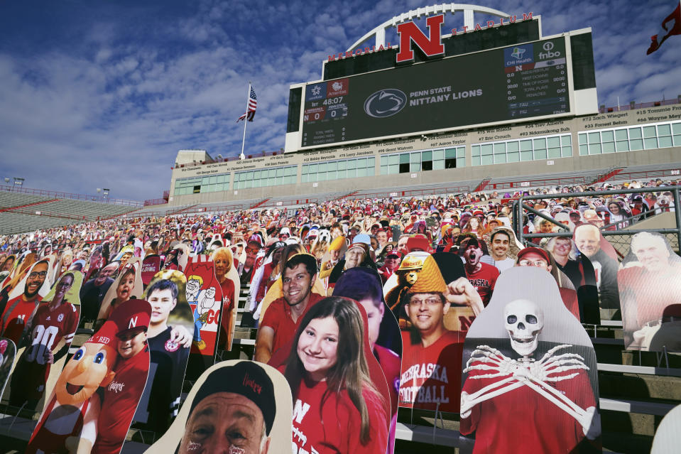 Cutouts of fans and other entities are attached to benches to fill up the empty stands in the time of COVID-19, before an NCAA college football game between Penn State and Nebraska, in Lincoln, Neb., Saturday, Nov. 14, 2020. (AP Photo/Nati Harnik)