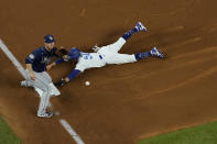 Los Angeles Dodgers right fielder Mookie Betts steals third past Tampa Bay Rays third baseman Joey Wendle during the fifth inning in Game 1 of the baseball World Series Tuesday, Oct. 20, 2020, in Arlington, Texas. (AP Photo/David J. Phillip)