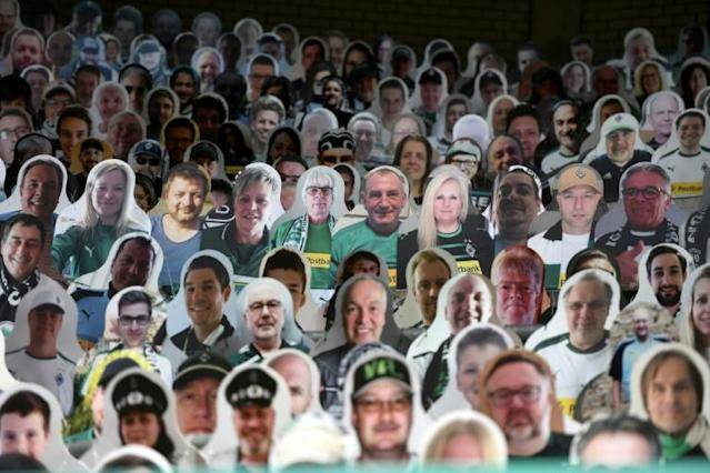Cardboard pictures of fans at the Bundesliga match between Borussia Moenchengladbach and Bayer Leverkusen (AFP Photo/Ina FASSBENDER)